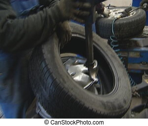 Dismantling of tire from rim. Car service station....