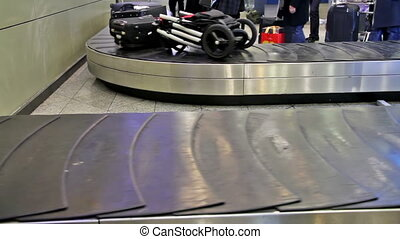 Luggage space - Passengers waiting for their luggage
