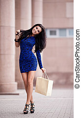 woman with a shopping bag - very beautiful young brunette...