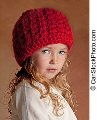 Toddler wearing a red knit hat
