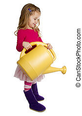 Toddler holding watering can