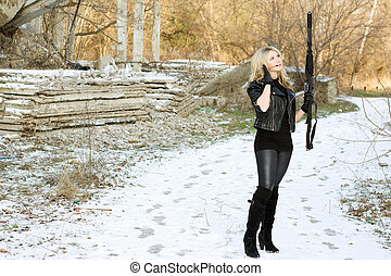 Attractive young woman with a gun