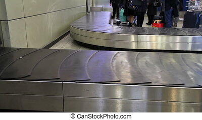 Baggage conveyor1 - movement of the conveyor belt baggage