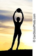 Silhouette of a woman - Silhouette of a young sporty woman...