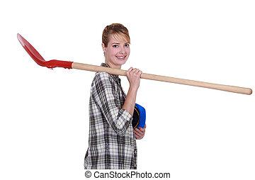 craftsman holding a shovel on his shoulder