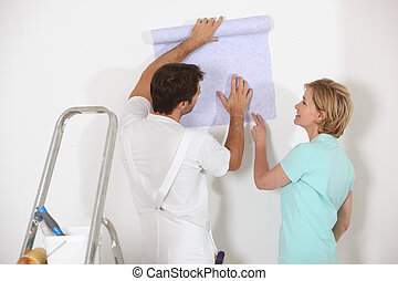 Man and woman choosing wallpaper