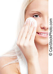 woman with cotton pads - beautiful young blond woman using...