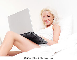 girl with a laptop - happy blond girl with a laptop on the...