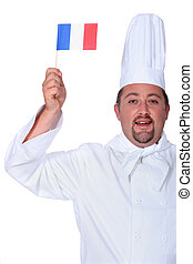 Chef holding miniature French flag