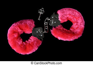 Love Cuffs - Pink furry handcuffs with a key closeup...
