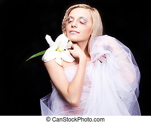blond bride - beautiful young blond bride with a lily and...