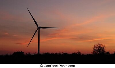 one windmill at orange sunset