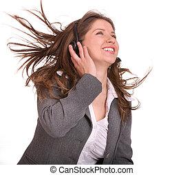 Woman wearing headset in suit.