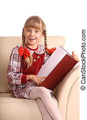 Girl sit in armchair and read book. Isolated.