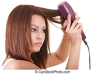 Beautiful girl with hair straightener. Isolated.