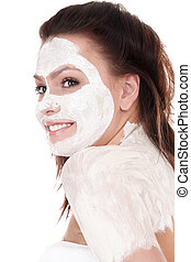 Girl with clay facial mask.
