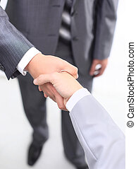 handshake of business partners after signing promising...