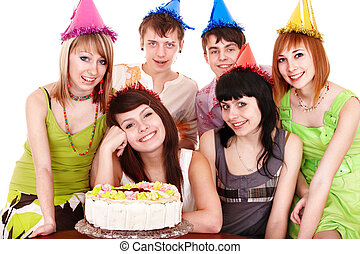 Group people in party hat with   cake.