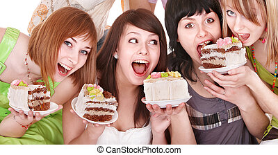 Group young woman eating cake. - Group of happy young woman...