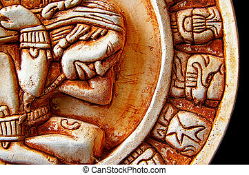 Closeup of glyphs on a Mayan calendar