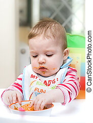 9 month old baby infant learning to eat by herself