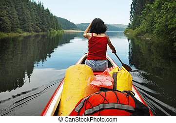 Canoeing girl on a lake