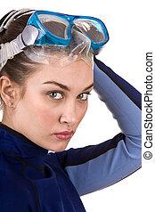 Girl scuba diver in goggles.