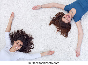 Happy people frame - teenagers laying on the floor