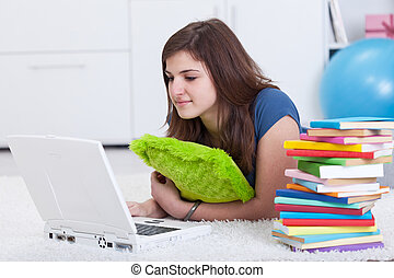 Teenager girl researching for a school project
