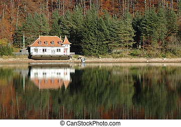 House near a lake - View of a lake house on Ighiu lake, with...