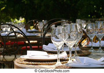 Banquet table in South afrika with glasses and napkins under...