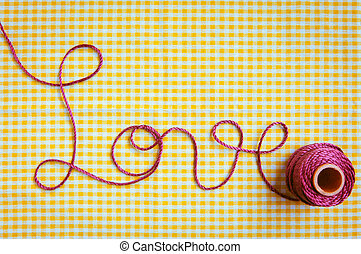Love Script in Crochet Yarn - The word love drawn out with...