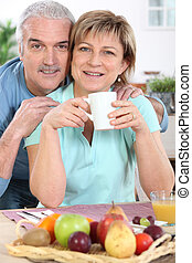 mature couple all smiles at breakfast