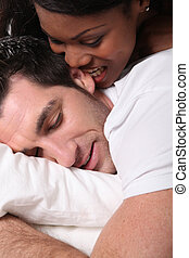woman, biting, her, husband's, ear, bed