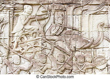 Bas relief at Bayon temple - bayon temple is famous for its...