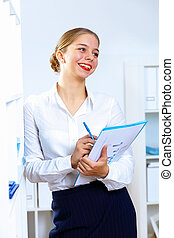 Young woman in business wear working in office - Young...