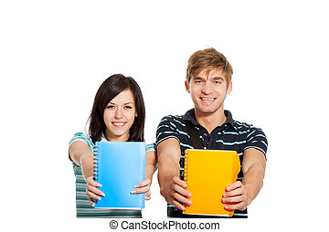 Young happy students couple smiling, holding notebooks