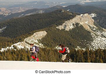 Winter landscape with trekkers