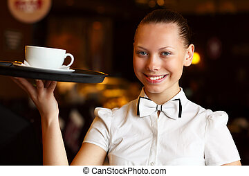 Portrait of young waitress holding a tray - Portrait of...