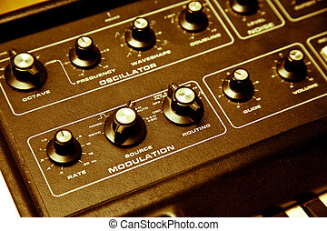 synthesizer with cloe-up of modulation - A yellow hued shot...