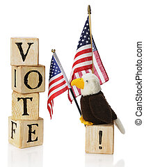 "Vote, USA - A toy bald eagle looking at the word ""VOTE""..."