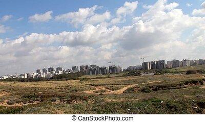 North Tel Aviv skyline from Tel Baruh hill. Landing a small...