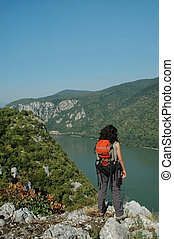 Danube river and the Cazanele gorge - Girl looking down to...