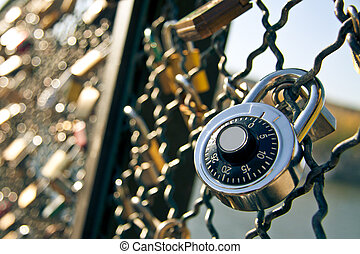 Padlock symbol of eternal love shot at Pont des Arts, Paris,...