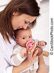 Baby girl drinking from bottle - Baby girl drinking from...