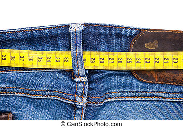Blue jeans and measure tape isolated - concept of overweight...
