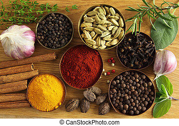 Spices ang herbs - Spices and herbs in metal bowls. Food and...
