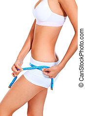 measuring - Slender woman measuring her hip. Diet, healthy...