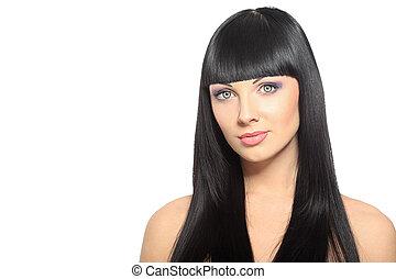 hair care - Beautiful brunette woman posing at studio....