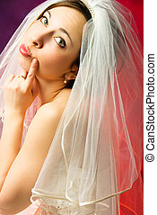 thoughtful bride - studio portrait of a thoughtful young...